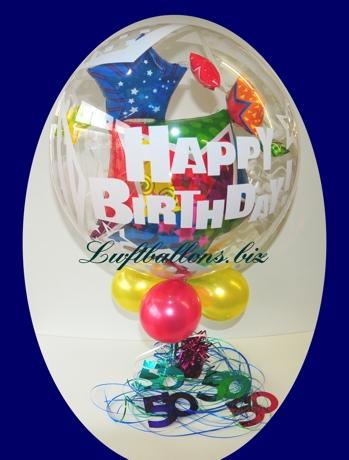 Bild. Bubble-Luftballon Happy Birthday dekoriert mit kleinen Luftballons. Zahlendeko 50