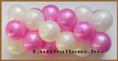 Ballongirlande aus kleinen Luftballons in den Farben Pink und Weiß